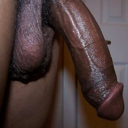 Hängender schwarzer Riesenpenis
